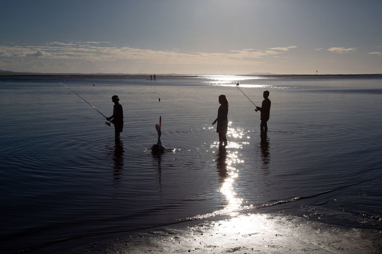 Place called 1770... just locals here... I felt like at the end of the world. Children are fishing alone :) Water Sea Beach Sky Land Group Of People Beauty In Nature Silhouette Horizon Over Water Horizon Sunset Nature Real People Leisure Activity Tranquility Lifestyles Scenics - Nature Child Reflection Outdoors Pelican 2018 In One Photograph Moments Of Happiness Backlight