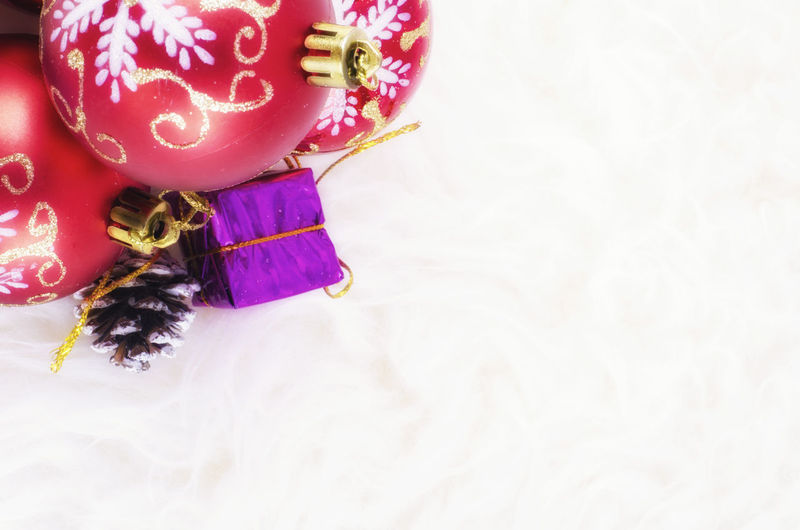 Closeup image of Christmas background with festival decoration Art And Craft Celebration Christmas Christmas Decoration Christmas Ornament Close-up Copy Space Decoration Easter Event Floral Pattern High Angle View Holiday Indoors  No People Ornate Pink Color Purple Still Life Studio Shot White Color