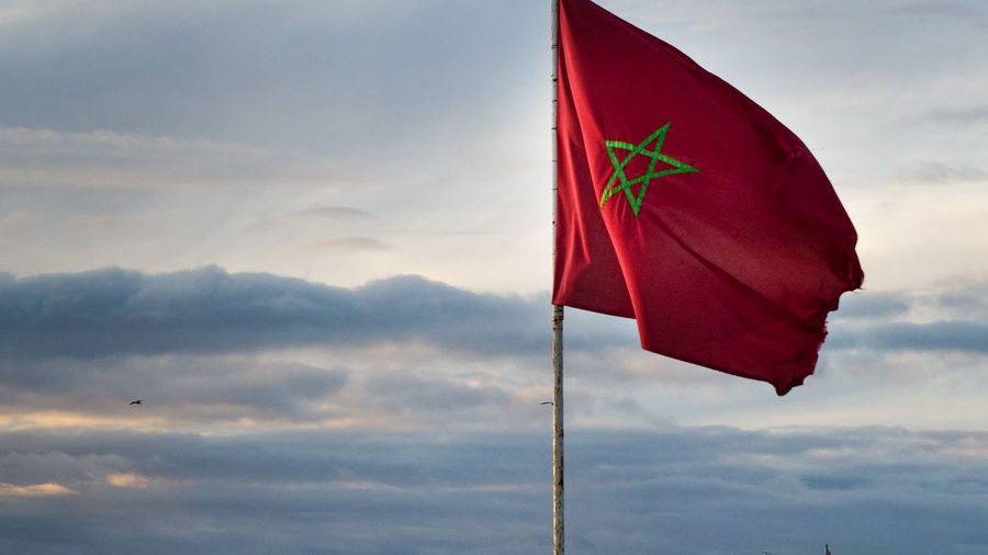 sunset Sky Flag Cloud - Sky Patriotism Red No People Environment Nature Wind Low Angle View Beauty In Nature Pole Outdoors Day Sunset Emotion Mountain Textile Waving Marocco Agadir Africa