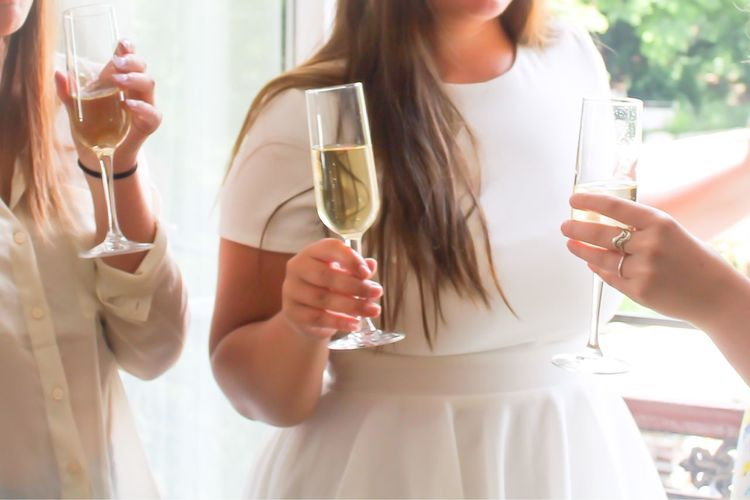 Close-Up Of Young Women Drinking Champagne