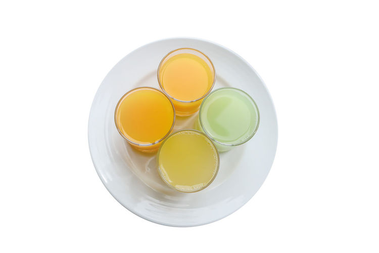 Apple Juice Circle Close-up Cut Out Directly Above Food Food And Drink Freshness Geometric Shape Glass Healthy Eating High Angle View Indoors  Juice Fruit No People Orange Juice In Glass Pineapple Juice Shape Still Life Studio Shot Wellbeing White Background Yellow