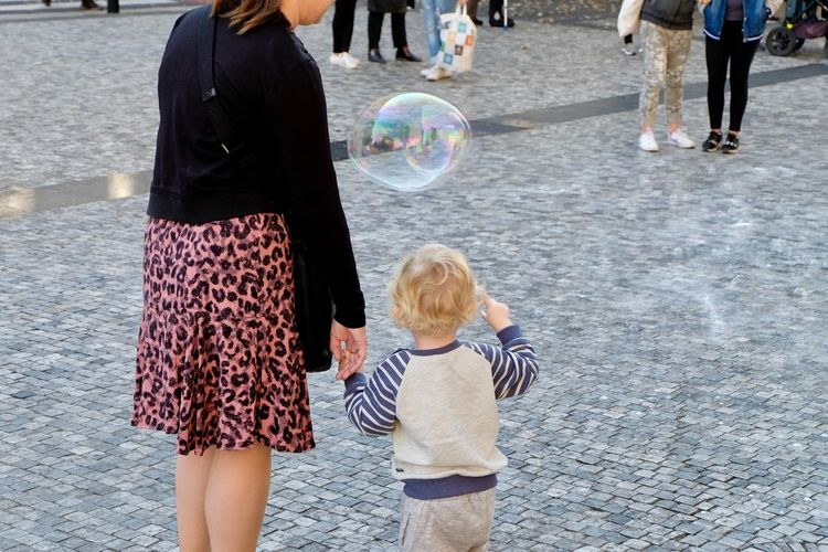 Childhood Child Women Real People Togetherness Females Family Street Two People City Leisure Activity Casual Clothing Men Lifestyles Bonding Bubble Rear View Girls Day Boys Positive Emotion Outdoors