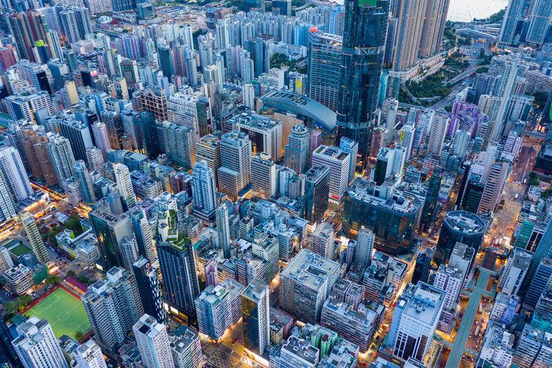 Aerial view of buildings in city against sky at dusk