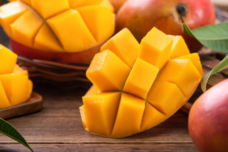 Close-up of chopped fruits on table