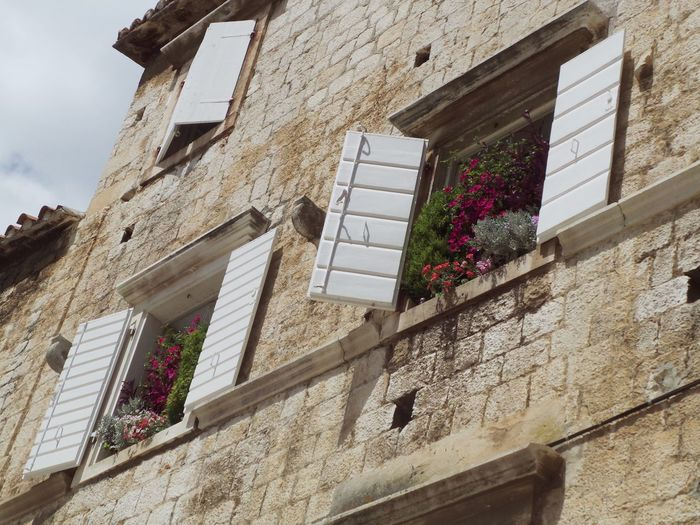 Adriatic Sea Architectural Feature Architecture Brick Wall Building Exterior Built Structure Cloud - Sky Croatia Dalmatia Day Detail Flower On Windowsill Low Angle View No People Old Buildings Old Town Outdoors Residential Building Shutters Sky Trogir Weathered Window Windows Beautiful Organized Neighborhood Map