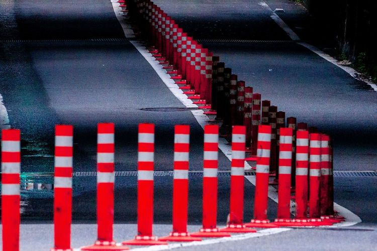 Red road by fence