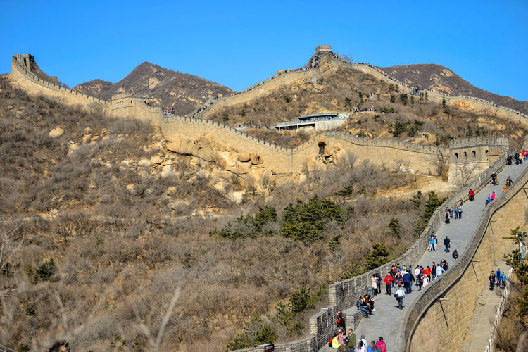 BADALING, CHINA - MARCH 13, 2016: Great Wall of China. Tourists visiting the Great Wall of China near Beijing. Beijing Great Wall Great Wall Of China Tourists UNESCO World Heritage Site Adult Architecture Border Brick Built Structure China Clear Sky Climate Crowd Day Group Of People Heritage Hill Historic Large Group Of People Leisure Activity Lifestyles Mountain Mountain Range Mountains Nature Old Outdoors Real People Scenics - Nature Sky Tourism Travel Travel Destinations Unesco Walking Women Wonder