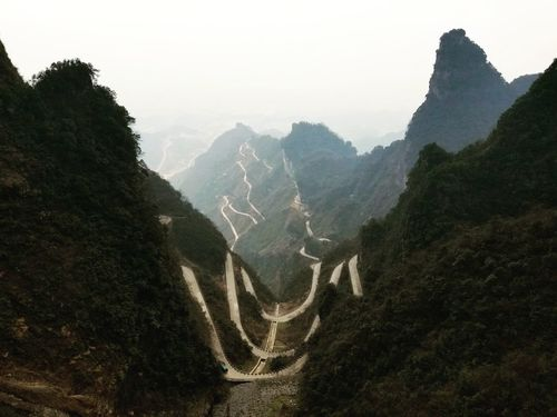 Winding road down Tianmen Mountain. Mountain Mountain Road Travel Travel Photography Zhangjiajie Tianmen Mountain China Explore Mountain Winter Cold Temperature Tree Sky Landscape Mountain Road Summer Road Tripping