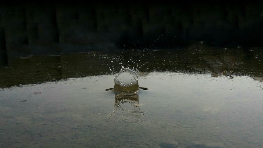 Water splashing on rock at night