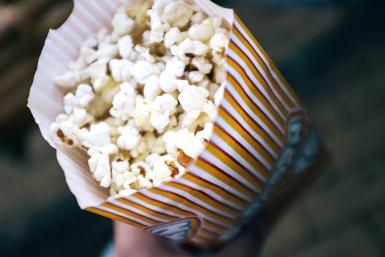 High angle view of popcorn in paper packet