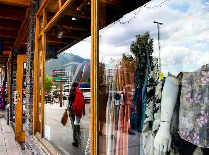 People walking in city seen through glass