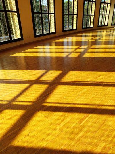 Sunlight falling on hardwood floor
