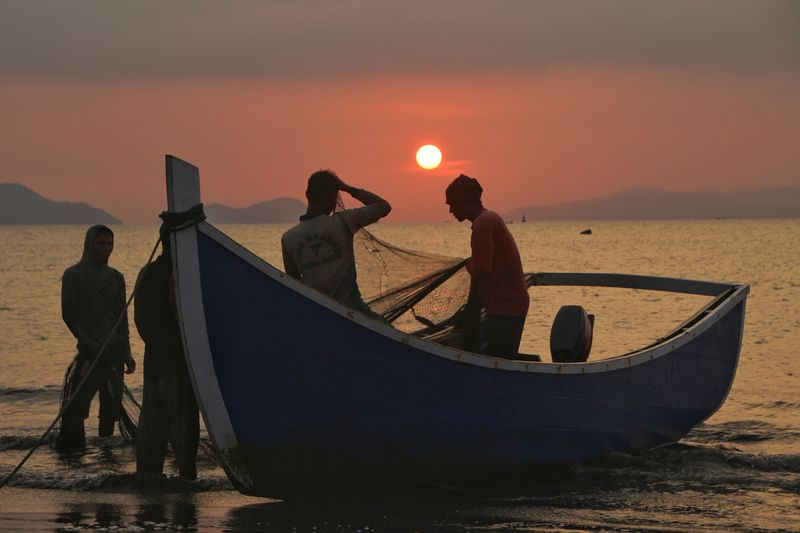 the Fisherman Aceh Fishing Fish INDONESIA Aceh Culture Photography Friendship Nautical Vessel Sea Water Sunset Sand Standing Beach Fisherman Togetherness Moon Surface Fishing Rod Commercial Fishing Net Full Moon Planetary Moon Moon Fishing Net Half Moon Silhouette Fishing Industry Shore Hiker Buoy Eclipse