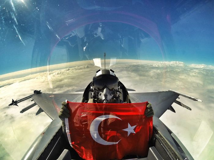 Pilot Holding Turkish Flag While Sitting In Fighter Plane