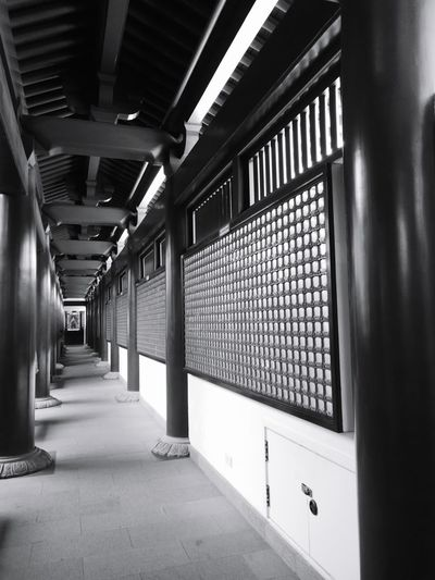 The pathway to respect the statute of Buddha Respect Peaceful Peace And Quiet Light Singapore Travel Light And Shadow Monochrome Buddhism Buddhist Temple Architecture Built Structure Passageway Ceiling Architectural Design Recessed Light Historic Passage Hallway Corridor
