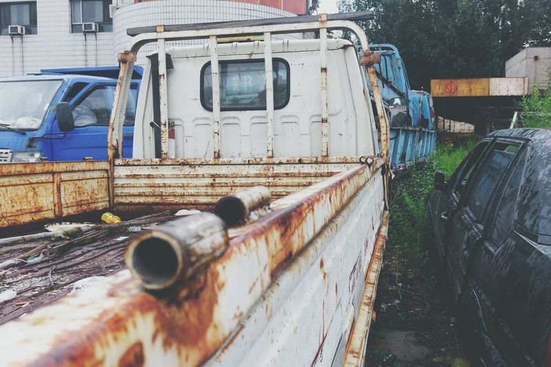 Close-Up Of Rusty Pick-Up Truck On Street