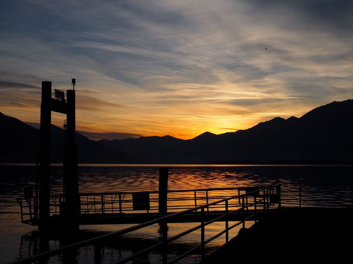Beauty In Nature Cloud - Sky Day Idyllic Lake Mountain Mountain Range Nature No People Outdoors Scenics Silhouette Sky Sunset Tranquility Travel Destinations Water