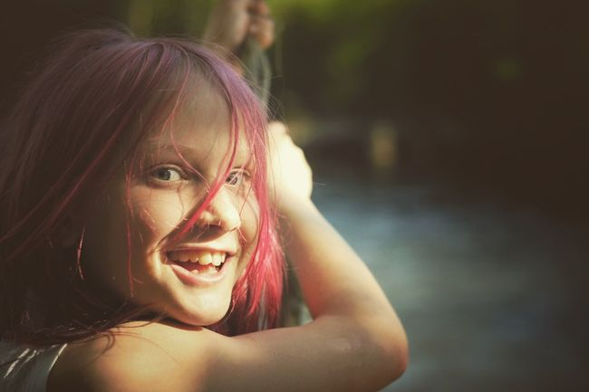 Daughter smiling before playing on the Rope Swing River Smiling Looking At Camera Lifestyles Outdoors