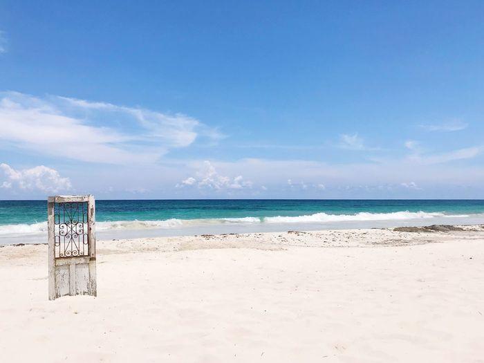 Tulum beach Quintana Roo Riviera Maya Mexico Tulum Paradise Door EyeEm Selects Water Beach Sea Land Sky Scenics - Nature Sand Tranquility Tranquil Scene Nature Cloud - Sky Horizon Over Water Day Outdoors No People Blue Idyllic Horizon Beauty In Nature First Eyeem Photo