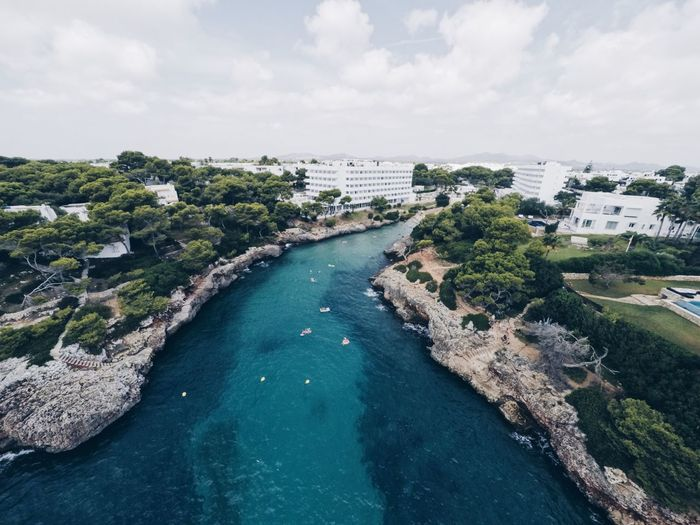 Welcome to vacation Calador Swimming Sea Beach Bay Vacations Holiday Hotel Mallorca EyeEm Selects Water Sea Built Structure Sky High Angle View Building Exterior Architecture Aerial View Cloud - Sky Outdoors Landscape Nature