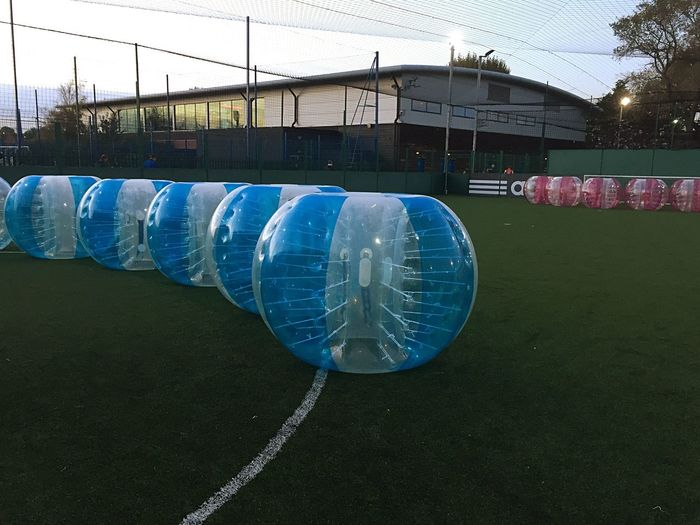 I think this is set up for some sort of party. Looks like it could be a lot of fun. Football Zorbing Sports Inflatables Fun Balls Party Running Bouncing Someone Will Get Hurt