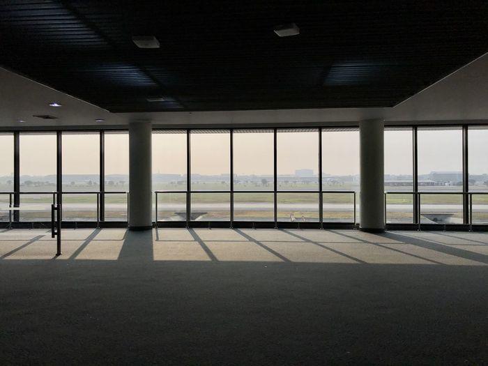 View of sea through glass window