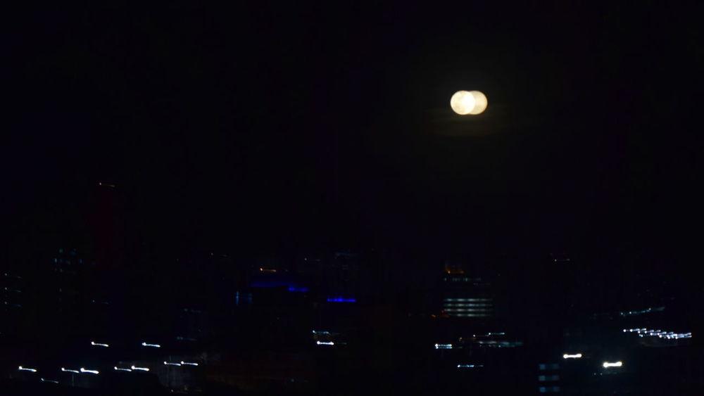 double moons :-) Astronomy Beauty In Nature Bright Moon Dark Illuminated Moon Nature Night No People Outdoors Scenics Shaky Sky Super Moon where did I put my glasses?