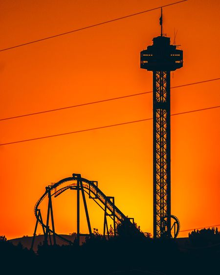 SIX FLAGS Sunset Sky Orange Color Architecture Silhouette Built Structure Low Angle View Nature No People Clear Sky Tower Connection Outdoors Tall - High Building Exterior Dusk Communication Metal Illuminated Amusement Park