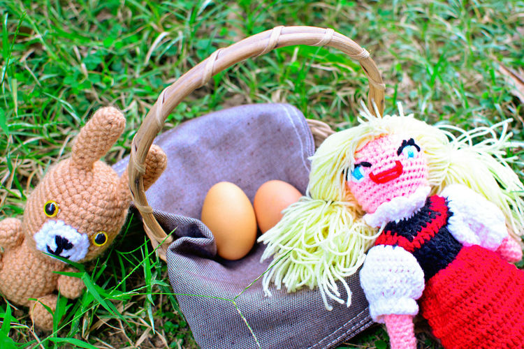 Funny Easter. Doll Animal Animal Representation Art And Craft Blond Hair Close-up Craft Creativity Day Girl Grass Holiday Multi Colored Nature No People Outdoors Plant Representation Stuffed Toy Toy