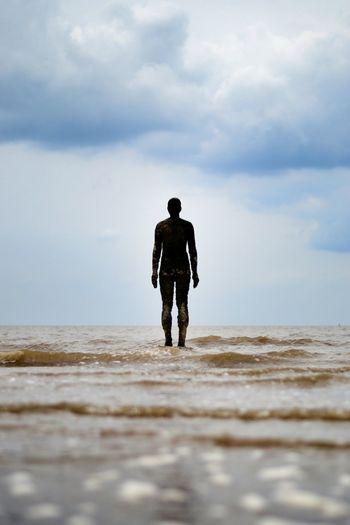 Statue on sea at beach