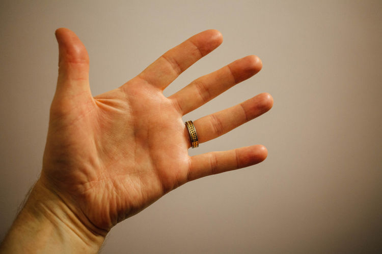 Cropped Hand Of Man Against Wall