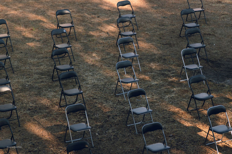 High angle view of chairs on field