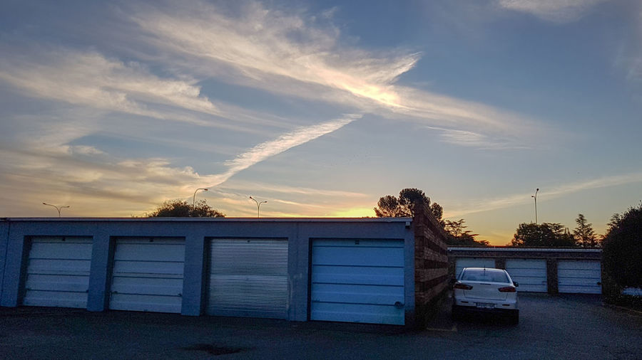 Bea EyeEm Selects Garage Door Calm Summer Road Fairweather Industry Colors Cold Temperature Dark Sunset Dawn Light And Shadow Light Sky Evening Travel Outdoors Dusk Sun Cloud - Sky Day Vehicle Architecture Built Structure Shadow Sunset Sky Padlock