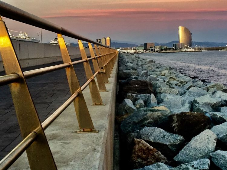 Industrial EyeEm Gallery Fence From My Point Of View Industrial Landscapes Power Lines HotelW Eye4photography  cityscapes Water Sea Sky Nature Sunset Cloud - Sky No People Built Structure Architecture Rock Beach Outdoors Horizon Over Water Building Exterior Rusty