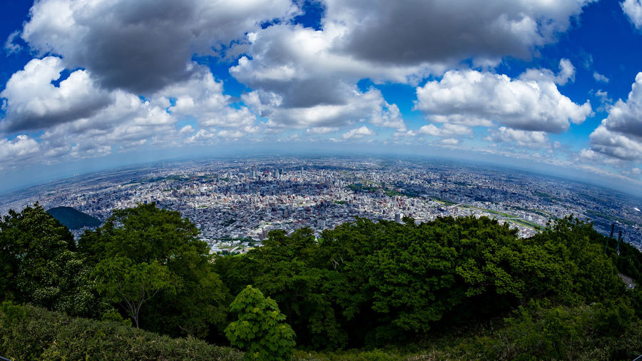 Atmospheric Layer Aerial View Architecture Beauty In Nature Blue Building Building Exterior Built Structure City Cityscape Cloud - Sky Curvature Of The Earth Day Environment Fisheye Mountain Peak Nature No People Outdoors Plant Residential District Scenics - Nature Sky Topofthemountain Tree