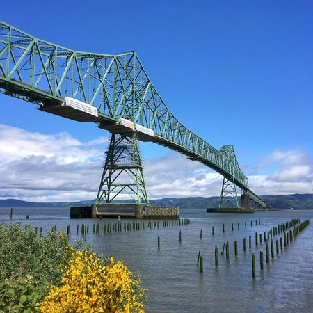 Bridge - Man Made Structure Connection Engineering Outdoors Built Structure Architecture Transportation Sky Day Blue Water No People Low Angle View Astoria, Oregon Columbia River Transportation Bay Span Spanning Bridge Bridging