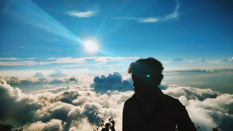 Portrait of silhouette man against blue sky