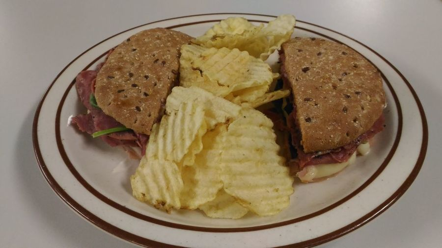 combo meat sandwich with spinach, cheese and chips. Sandwich Sandwich And Chips Flatbread  Potato Chip On The Plate Sandwiches Sandwich Time Quick Meal Meal Time Lunch Lunch Time! Indoors  SLICE Close-up Healthy Eating Freshness