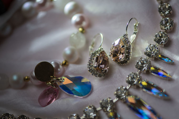 Silver ,pearl and gold jewelry on the table. background of jewelry.