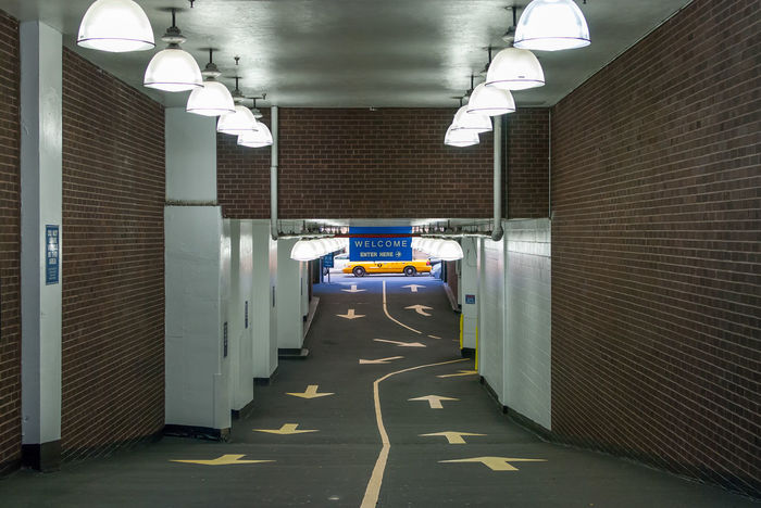 Interior design of garage with road yellow arrow markings. Garage with yellow cab background. City design and art. Empty driveway and design. Halogen lamp interior. Black And White Black And White Photography Car Ram City City Design City Details Driveway Floor Design Garage Garage Interior Halogen Halogen Lamp Halogen Lamps Halogen Lights Industrial Industrial Building  Industrial Design Interior Design Interior Detail Minimalism Road Arrow Road Marking Taxi Urban Geometry Yellow Cab
