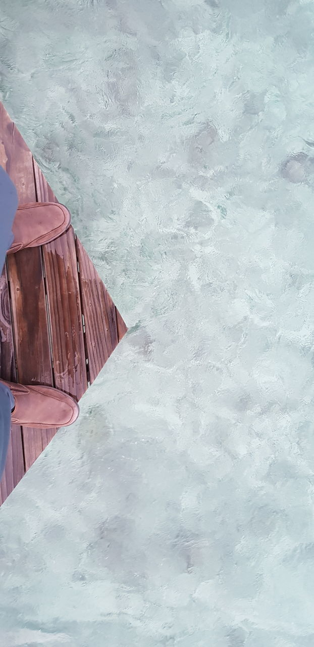 HIGH ANGLE VIEW OF FROZEN SWIMMING POOL DURING WINTER