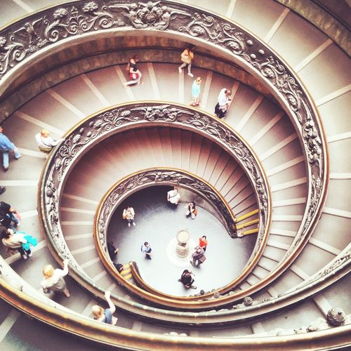 People Walking In Spiral Staircase At Vatican Museum