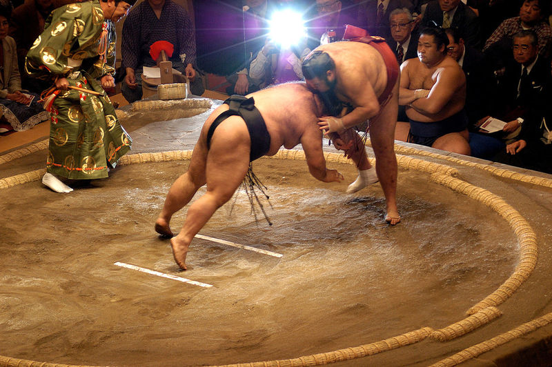 Action Adult Arts Culture And Entertainment ASIA Circle Culture Day Fighting Full Length Heritage Indoors  Japan Lifestyles Men One Person People Real People Skill  Sport Sporting Action Sumo Sumo Wrestlers Sumo Wrestling Two Wrestlers