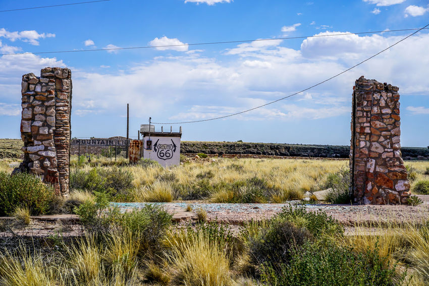 A ghost town in the desert of Arizona it was once a thriving town along a historic route and now sits abandoned and crumbling. Brick Wall Business Desert Grass Houses Roads Rock Zoo Blue Sky Buildings Clouds Fields Homes Route Sky Stone Structures Sunshine