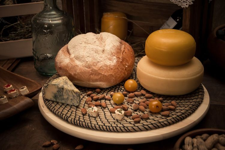 Bread with almonds in plate on table