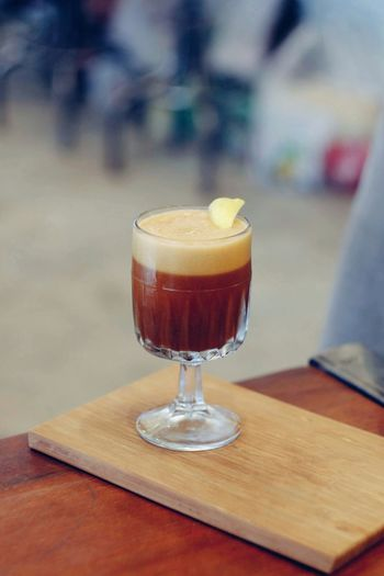 Glass of coffee on wood table Morning Refreshment Cafe Tasty Coffee Relax Business Break Breakfast Aroma Caffeine Beverage Barista Freshness Drink Fresh Still Life Cold Drink Glass Shop Lifestyle Espresso