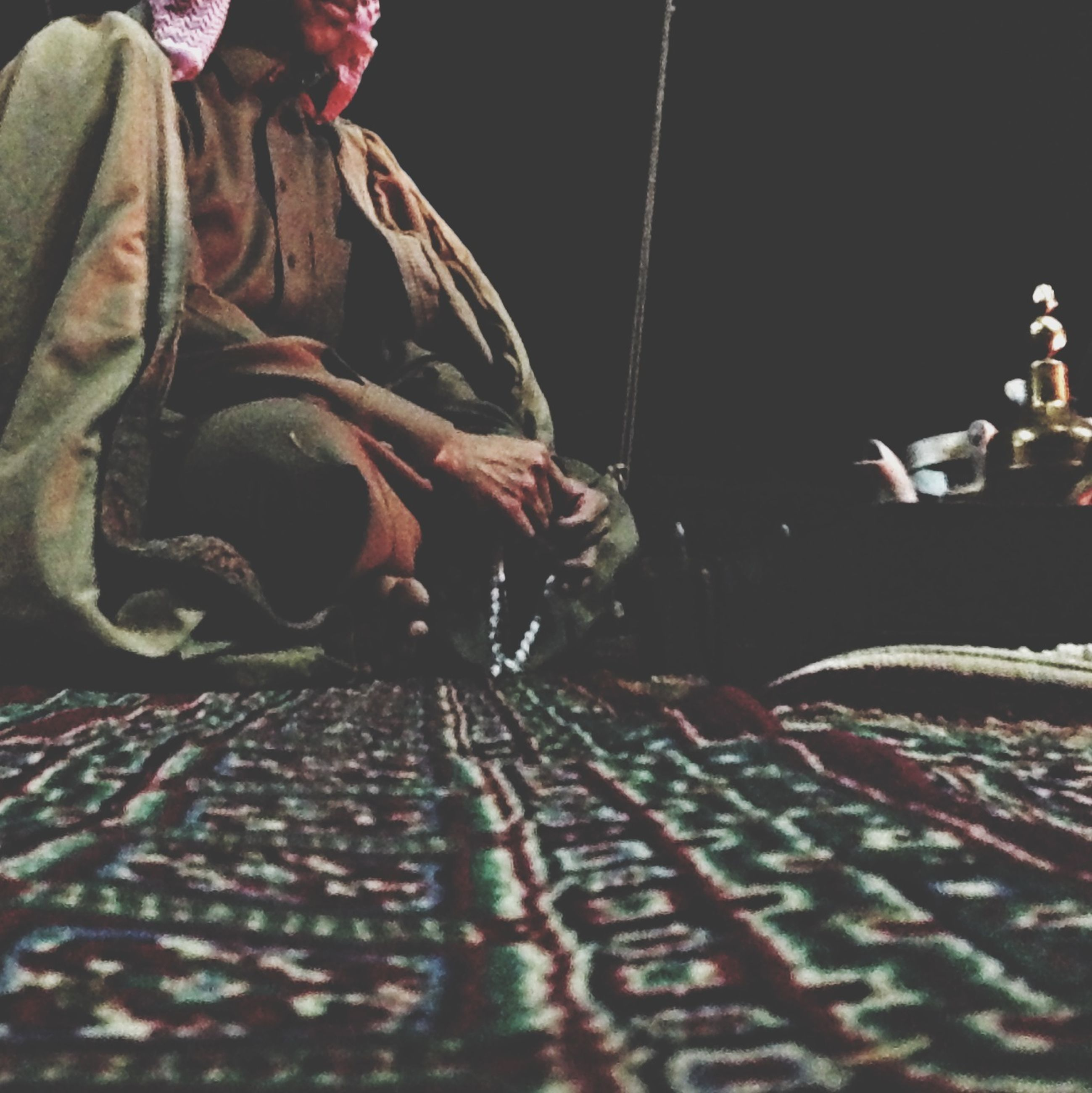 indoors, men, low section, textile, art and craft, night, fabric, tradition, lifestyles, pattern, art, person, close-up, unrecognizable person, cultures, religion