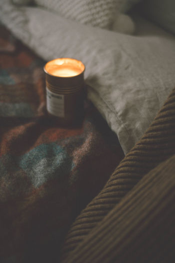 Indoors  Bed Still Life No People Orange Color Furniture Selective Focus Close-up Textile High Angle View Bedroom Healthcare And Medicine Table Blanket Illuminated Container Pill