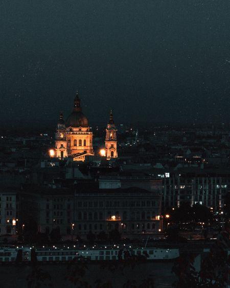Illuminated church in city at night