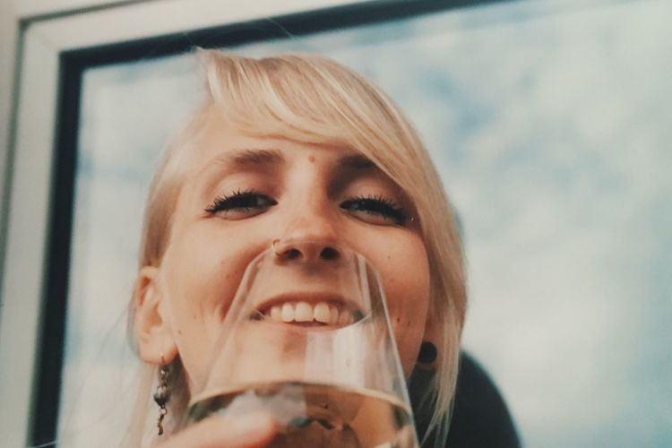 wine time One Woman Wine Smiling Millenials Young Women Young Adult Drinking Wine Sunny Day Real People One Person Headshot Looking At Camera Portrait Front View Indoors  Close-up Focus On Foreground Lifestyles Person Innocence Day Orange Color Facial Expression Human Face